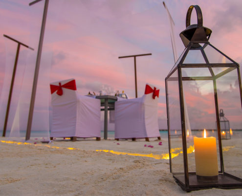 Maldives Resorts - Beach - Dinner - Couple - Hideaway Beach Resort & Spa